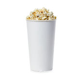 Popcorn isolated in cardboard box on a white Royalty Free Stock Photo