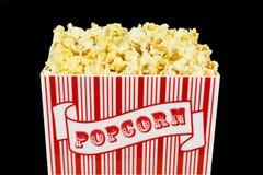 Popcorn isolato sopra il nero Fotografia Stock