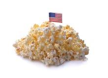 Popcorn isolato su una priorità bassa bianca Immagine Stock