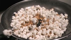 Popcorn jumping in super sow motion stock footage