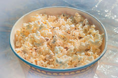 Popcorn in a large glass on the table Stock Image