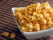 Popcorn. A late-night snack of cheese popcorn stock images