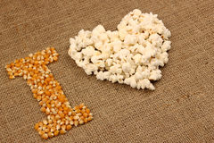 Popcorn love Stock Images