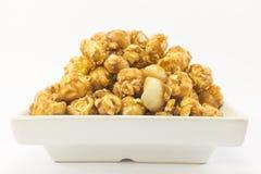Popcorn with macadamia caramel flavour. Stock Photo
