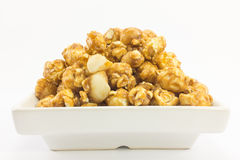 Popcorn with macadamia caramel flavour. Royalty Free Stock Photography