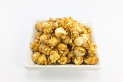 Popcorn with macadamia caramel flavour. Royalty Free Stock Image