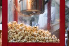 Popcorn machine. Closeup popcorn in popcorn machine Royalty Free Stock Photography