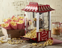 Popcorn. Machine on wood table and brick background Stock Images