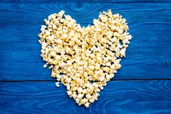 Popcorn mockup on blue background top view copy space. Heart shape stock images