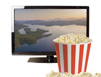 Popcorn and modern LCD TV Royalty Free Stock Photos