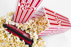 Popcorn and a Movie. Home entertainment concept with  some popcorn, and a couple of DVD movies Stock Photography