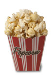 Popcorn and movie. Close up of two tickets stubs in a box of popcorn Royalty Free Stock Images