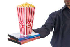 Popcorn movie. Man giving some popcorn at a movie Stock Photography