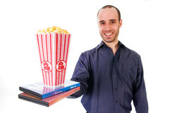 Popcorn movie. Man giving some popcorn at a movie Stock Images