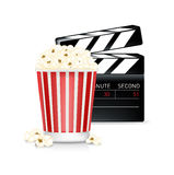Popcorn and movie clipper isolated on white Stock Photo