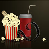 Popcorn and movie  film. Popcorn and movie film on dark background Royalty Free Stock Photos