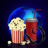 Popcorn and movie  film. Popcorn and movie film  on dark space background Royalty Free Stock Photos