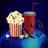 Popcorn and movie  film. Popcorn and movie film  on dark space background Stock Photography
