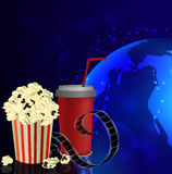 Popcorn and movie  film. Popcorn and movie film on dark space background Stock Image