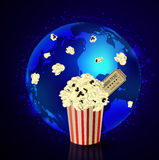 Popcorn and movie ticket Stock Photography