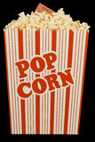 Popcorn and Movie Ticket Isolated on Black Stock Photos