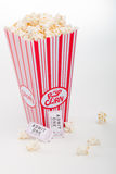 Popcorn and movie tickets. A carton of popcorn and movie tickets Stock Photography