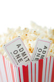 Popcorn and movie tickets. A carton of popcorn and movie tickets Royalty Free Stock Photos