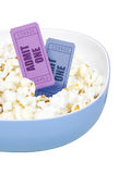 Popcorn and movie tickets. On white Stock Image