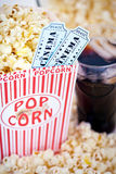 Popcorn and Movie Tickets. Popcorn, two movie tickets and soda Royalty Free Stock Photography