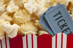 Popcorn and movie tickets. Close up of two tickets stubs in a box of popcorn Stock Photography