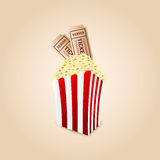 Popcorn and movie tickets Stock Photo