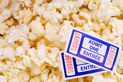 Popcorn And Movie Tickets. Two Cinema Tickets Against A Background Of Movie Popcorn Stock Photos
