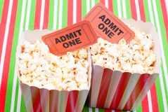 Popcorn on movie tickets desk top view. Popcorn  movie tickets desk top view Stock Images
