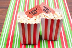 Popcorn on movie tickets desk top view. Popcorn  movie tickets desk top view Royalty Free Stock Photo