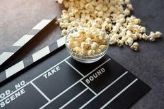 Popcorn and movie time. Clapboard Royalty Free Stock Image