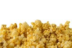 Popcorn nella fine su sul fondo dell'isolato Fotografia Stock Libera da Diritti
