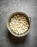 Popcorn in an old pot. Stock Image