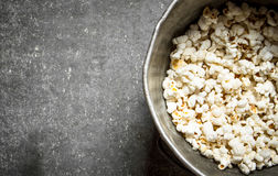 Popcorn in an old pot. Royalty Free Stock Image