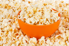 Popcorn in a orange bowl Stock Photo