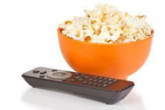 Popcorn in a orange bowl and remote control Stock Photo