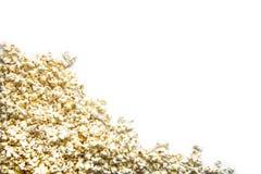 Popcorn på vit bakgrund royaltyfria bilder