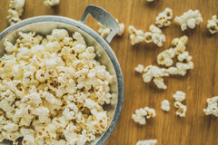 Popcorn. In the pan on a wooden table Royalty Free Stock Photography