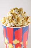 Popcorn in a paper cup Stock Image