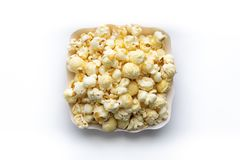 Popcorn in paper cup isolate on white background.  royalty free stock photo