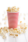 Popcorn in paper cup. Royalty Free Stock Photography