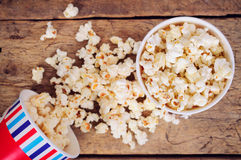 Popcorn in paper cups on wooden surface. Top view Stock Photo