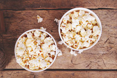 Popcorn in paper cups on wooden surface. Top view Royalty Free Stock Images