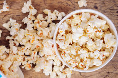 Popcorn in paper cups on wooden surface. Top view Stock Photography