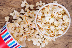 Popcorn in paper cups on wooden surface. Top view Stock Image