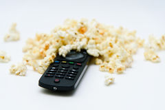 Popcorn pile close-up and tv control. Popcorn pile close-up and black tv remoute Royalty Free Stock Photography